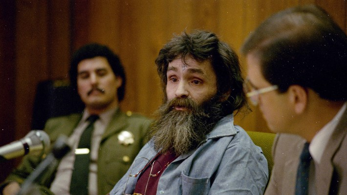 Charles Manson (center), seen during a parole hearing in California in 1986.