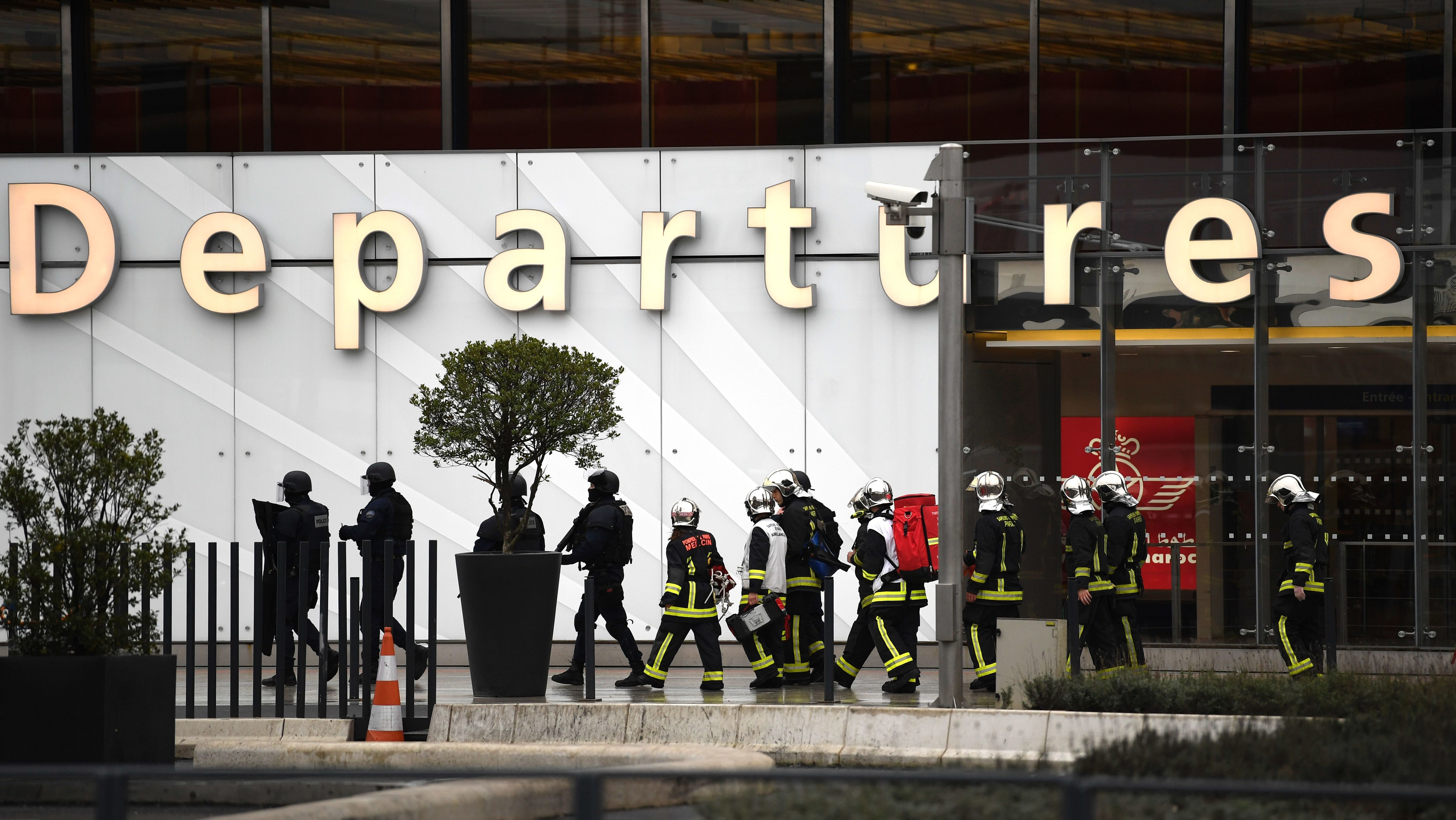French firefighters and police officers secure Orly airport outside Paris on Saturday after the shooting of a man by French protection forces. The attacker had been recognized to French authorities, and his house have been looked after assaults in 2015.
