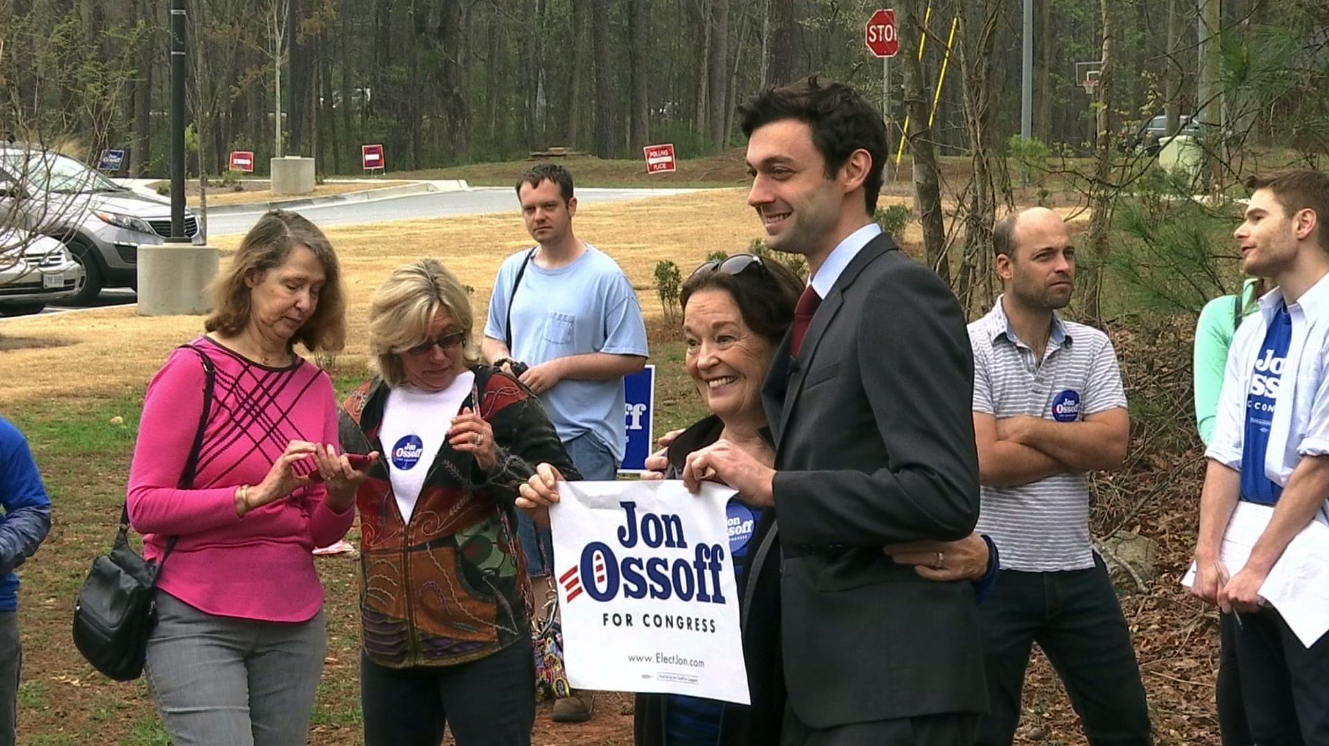 Democratic congressional candidate Jon Ossoff poses with supporters outside of the East Roswell Branch Library in Roswell, Ga.