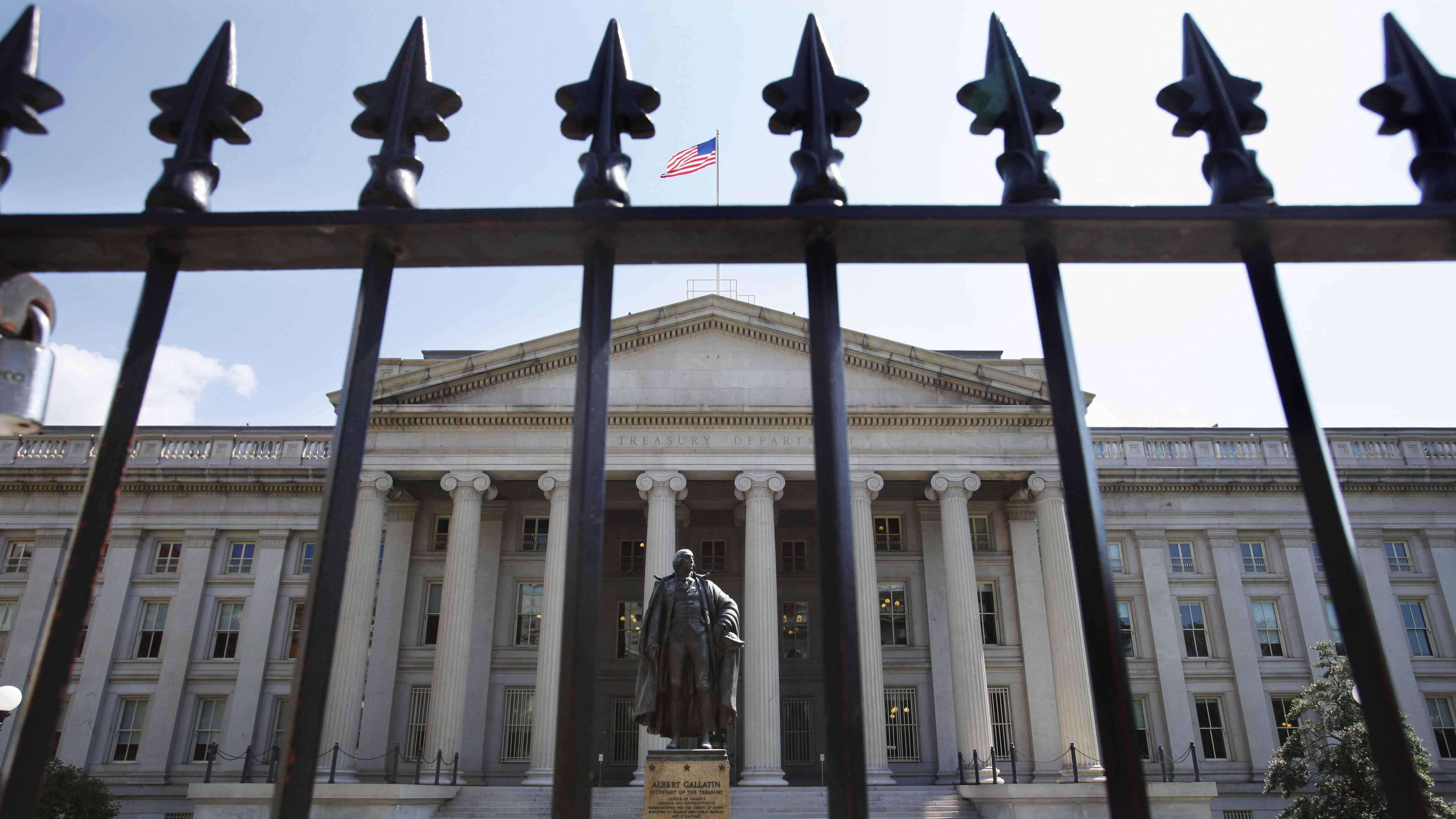 A statue of former Treasury Secretary Albert Gallatin stands guard outside the Treasury Building in Washington. Trump