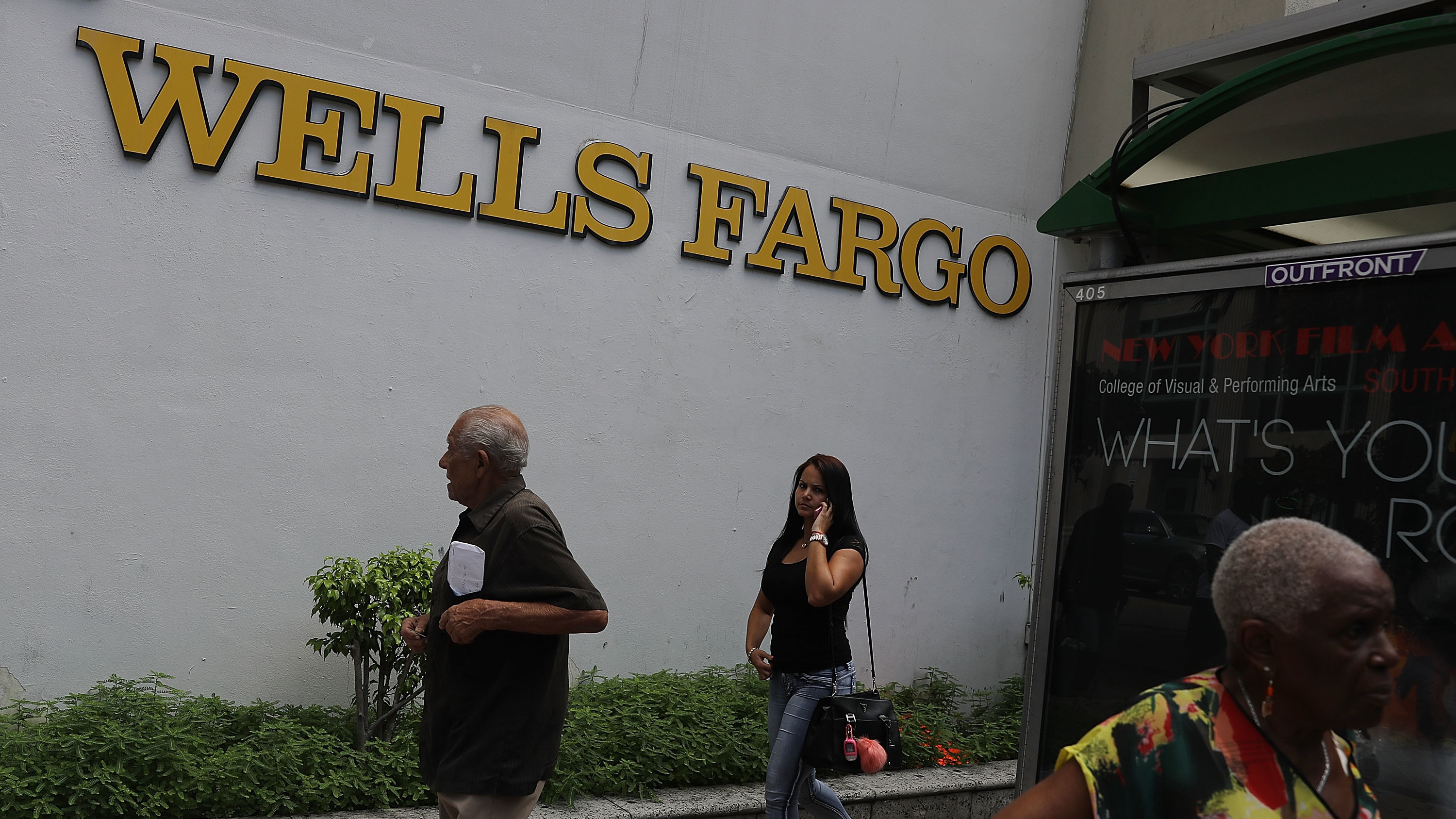 People walk in front of a Wells Fargo branch on Sept. 9, 2016 in Miami, Fla. On Monday, the U.S. Supreme Court ruled that the city of Miami can sue Wells Fargo and Bank of America under the Fair Housing Act for damages caused by allegedly predatory and discriminatory lending practices.