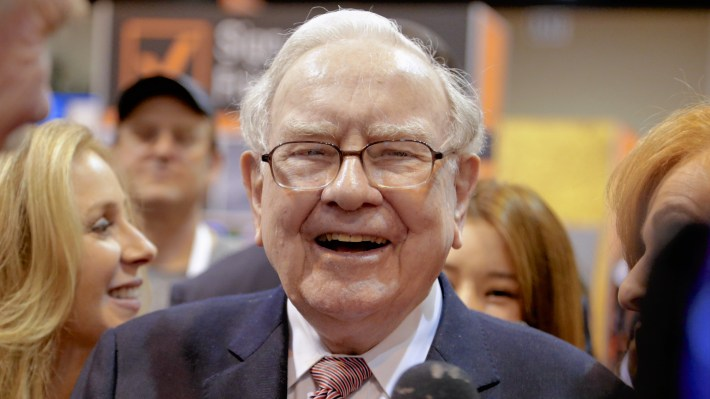 Berkshire Hathaway Chairman and CEO Warren Buffett visits the exhibit floor in Omaha, Neb., Saturday, where company subsidiaries display their products during the annual shareholders meeting.