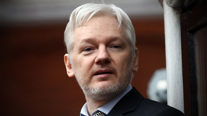 Wikileaks founder Julian Assange speaks from the balcony of the Ecuadorian Embassy in London on 2016. He has sought asylum there since 2012, when Sweden filed an extradition request on the allegation of rape — an allegation Swedish prosecutors said Friday they are dropping.