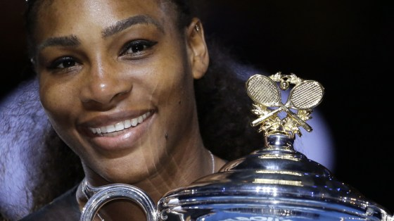 Serena Williams holds her trophy after winning the women