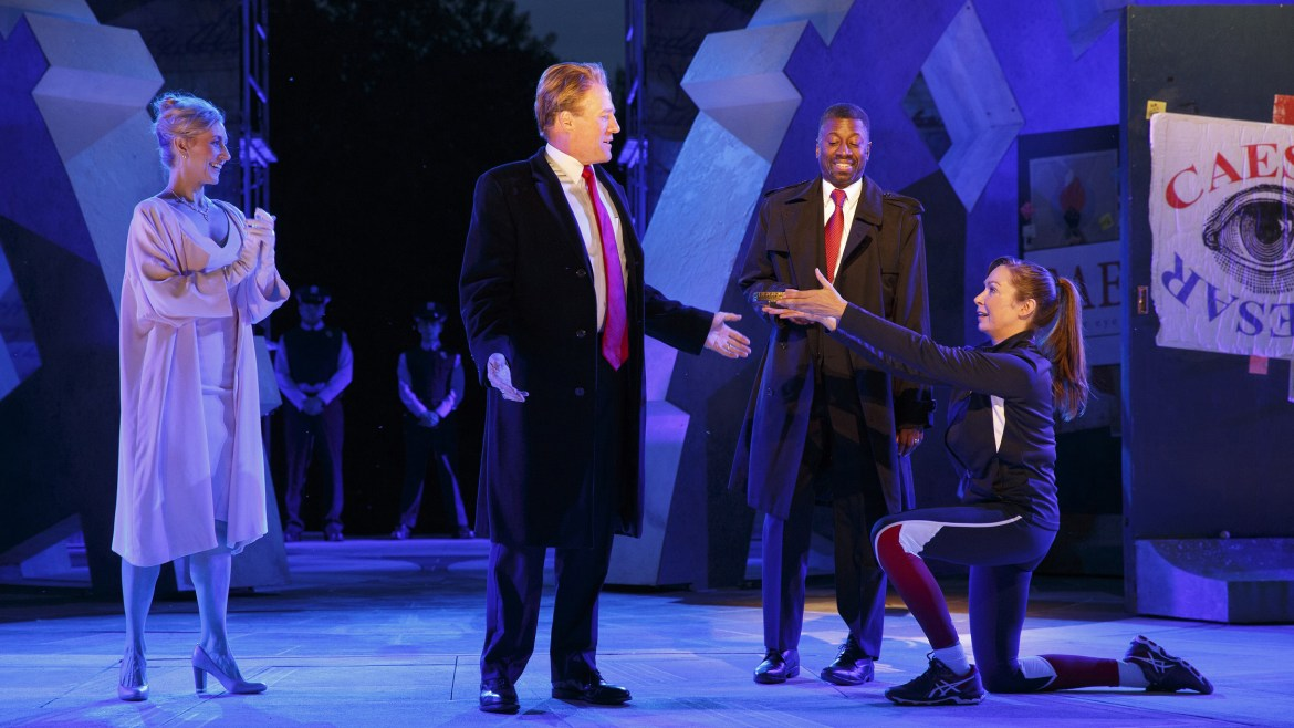In this May 21, 2017, photo provided by The Public Theater, Tina Benko, left, portrays Melania Trump in the role of Caesar