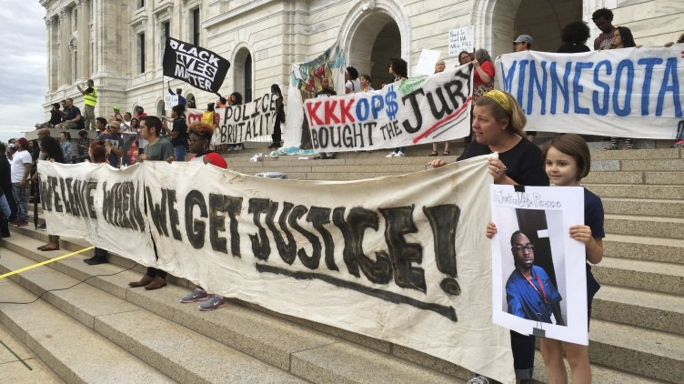 Protesters gather outside the state Capitol in St. Paul, Minn., Friday, June 16, 2017, after St. Anthony police officer Jeronimo Yanez was cleared in the fatal shooting of Philando Castile.