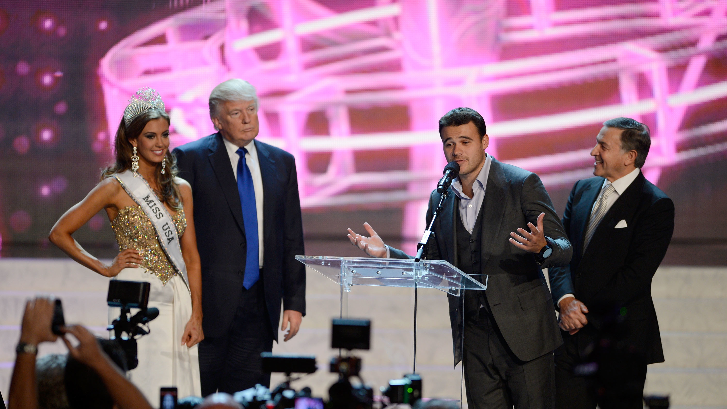 From left, Miss Connecticut USA Erin Brady and Donald Trump look on as Russian singer Emin Agalarov speaks onstage with his father Aras Agalarov during a news conference after Brady won the Miss USA 2013 pageant on June 16, 2013, in Las Vegas.