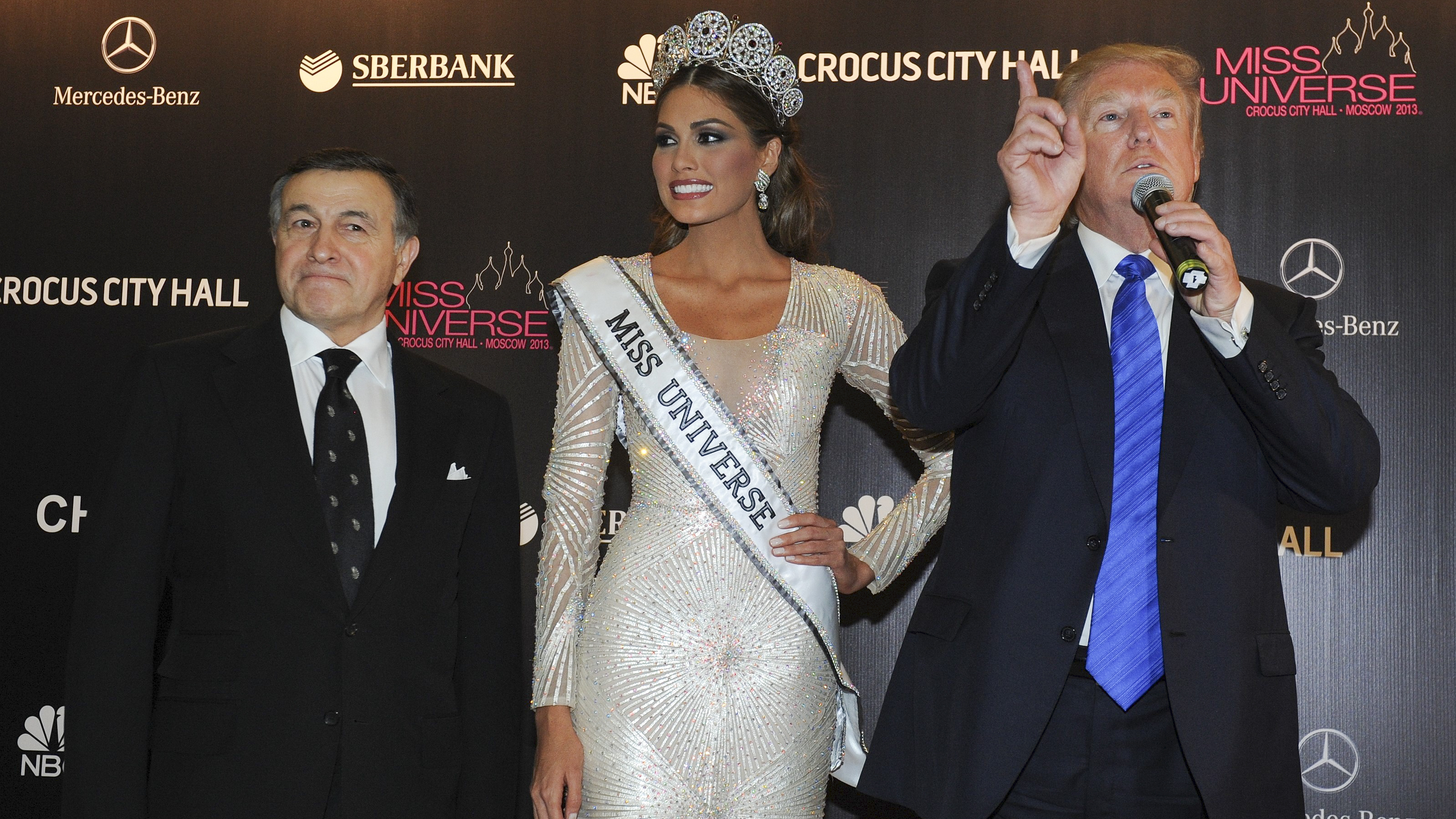 In this file photo taken on Sunday, Nov. 10, 2013, Russian businessman Aras Agalarov, left, Miss Universe 2013 Gabriela Isler, from Venezuela, center, and pageant owner Donald Trump attend the final of the 2013 Miss Universe pageant in Moscow, Russia.