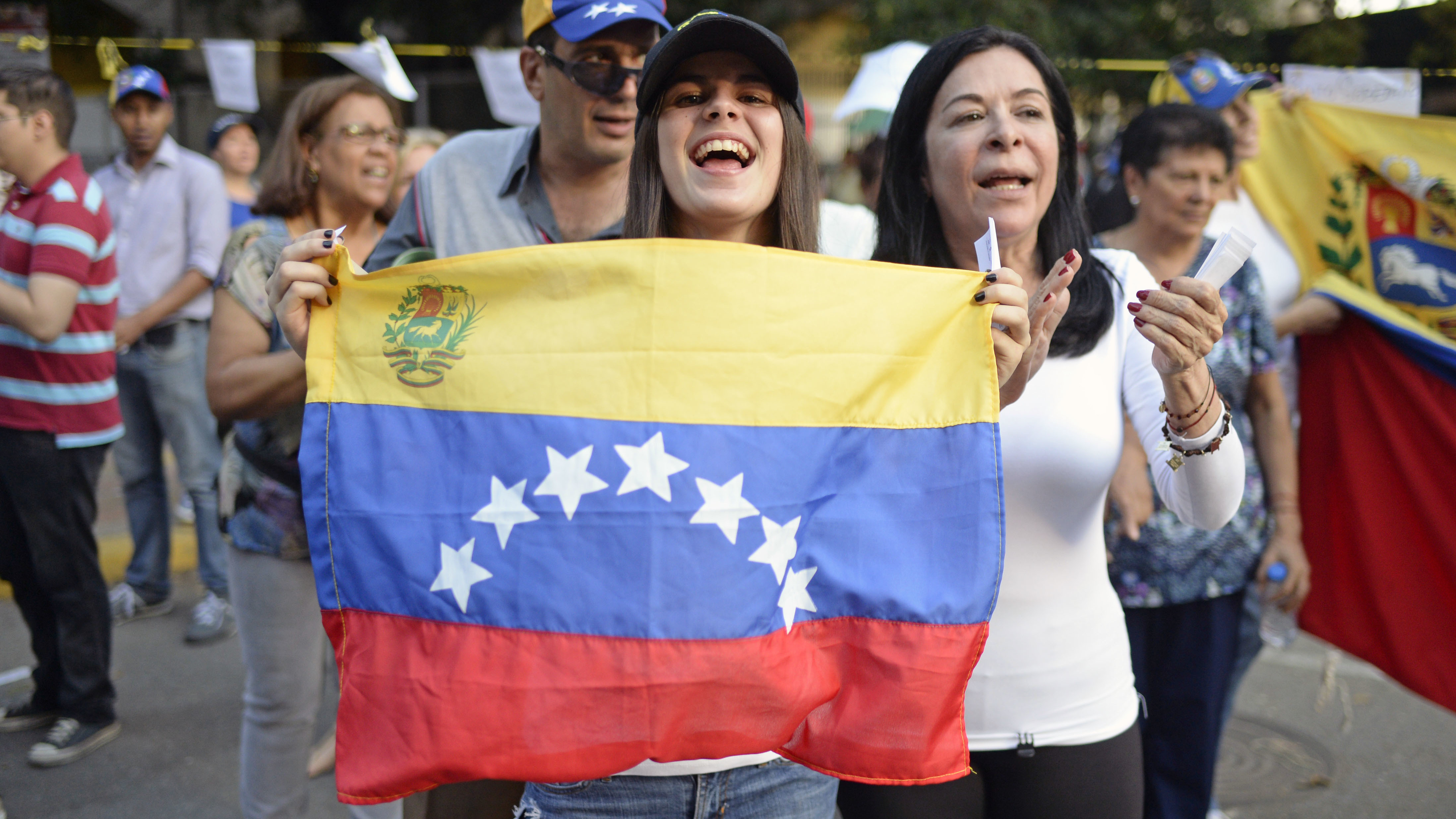 Activists celebrate Sunday in Caracas after voting in an opposition-organized referendum on President Nicolas Maduro