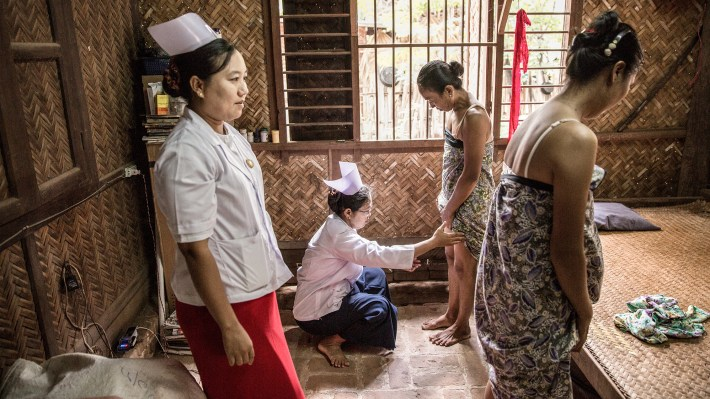 Health-care workers screen women for leprosy in the town of Nyaung U in Myanmar.