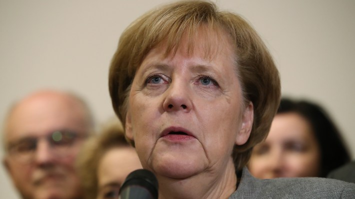 German Chancellor and leader of the German Christian Democrats (CDU) Angela Merkel, stands with leading members of her party, as she speaks to the media after preliminary coalition talks collapsed on Sunday.