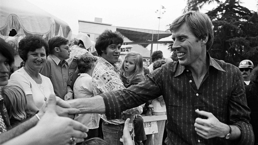 Former Democratic Sen. John Tunney greets supporters at a 1976 Jimmy Carter campaign stop in Pomona, Calif. Tunney died Friday, at age 83.