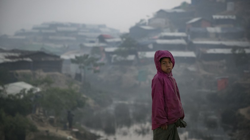 A Rohingya refugee stands in a displaced-persons camp in Cox