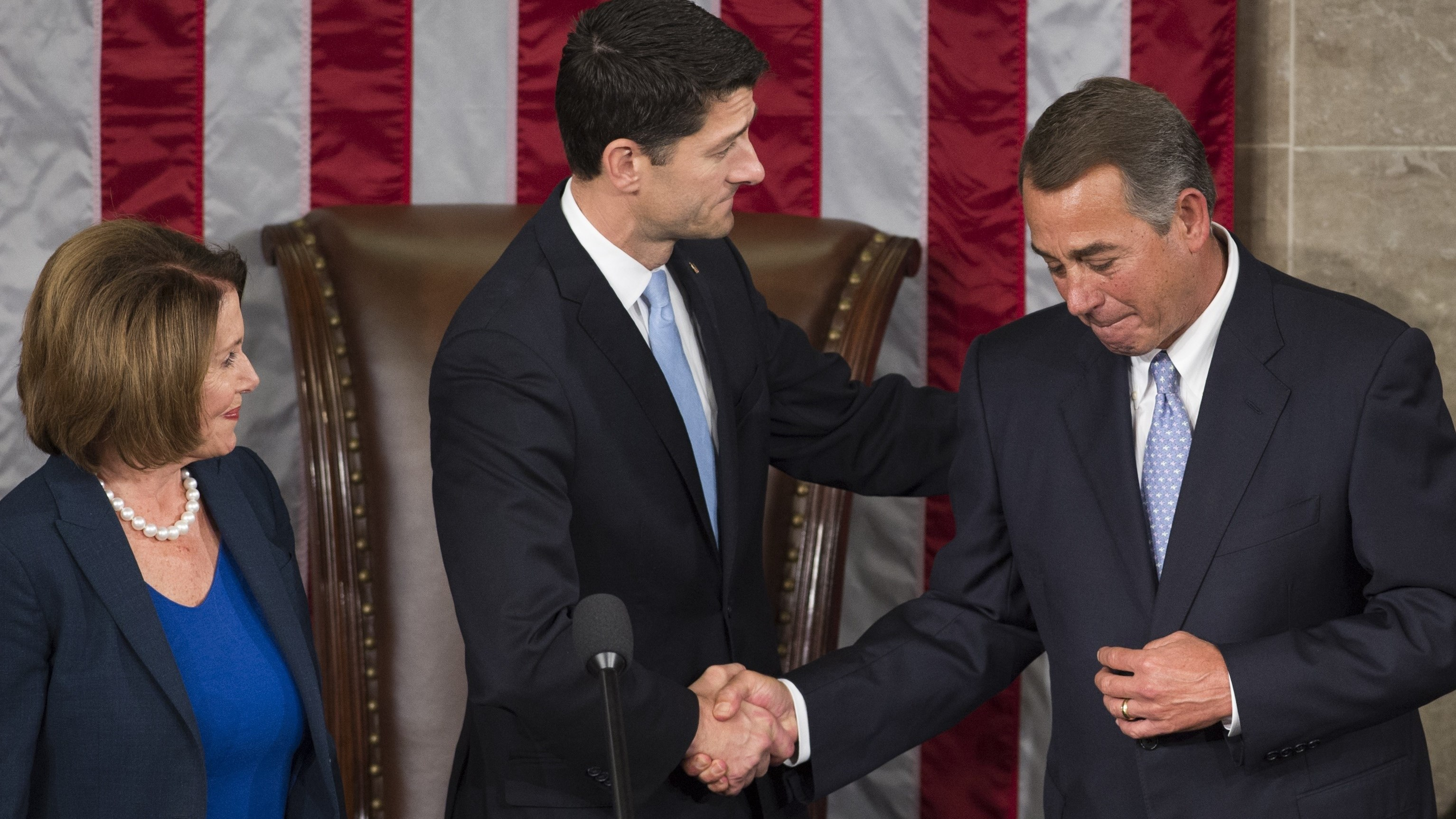Then newly elected Speaker of the House Paul Ryan shakes hands with outgoing Speaker John Boehner alongside House Democratic Leader Nancy Pelosi at the U.S. Capitol in Washington, D.C., Oct. 29, 2015.