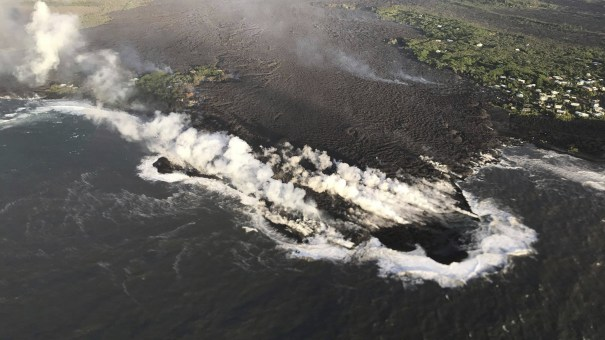 A U.S. Geological Survey photo shows lava entering the ocean at Kapoho Bay, Hawaii, on Tuesday. A morning overflight confirmed that lava had completely filled the Bay.