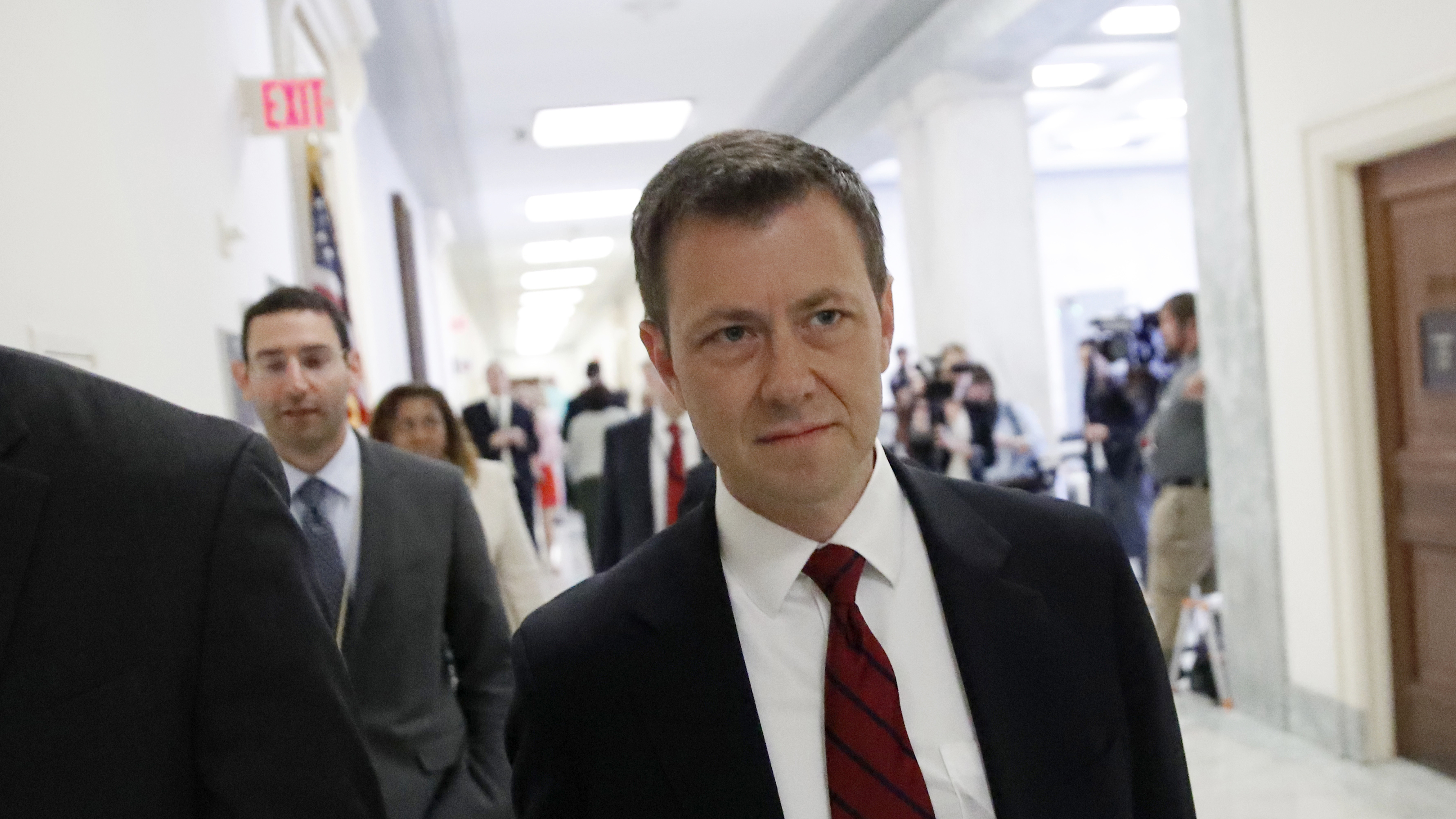 Peter Strzok, center, before he speaks behind closed doors to the House Judiciary Committee on Capitol Hill on June 27, 2018.