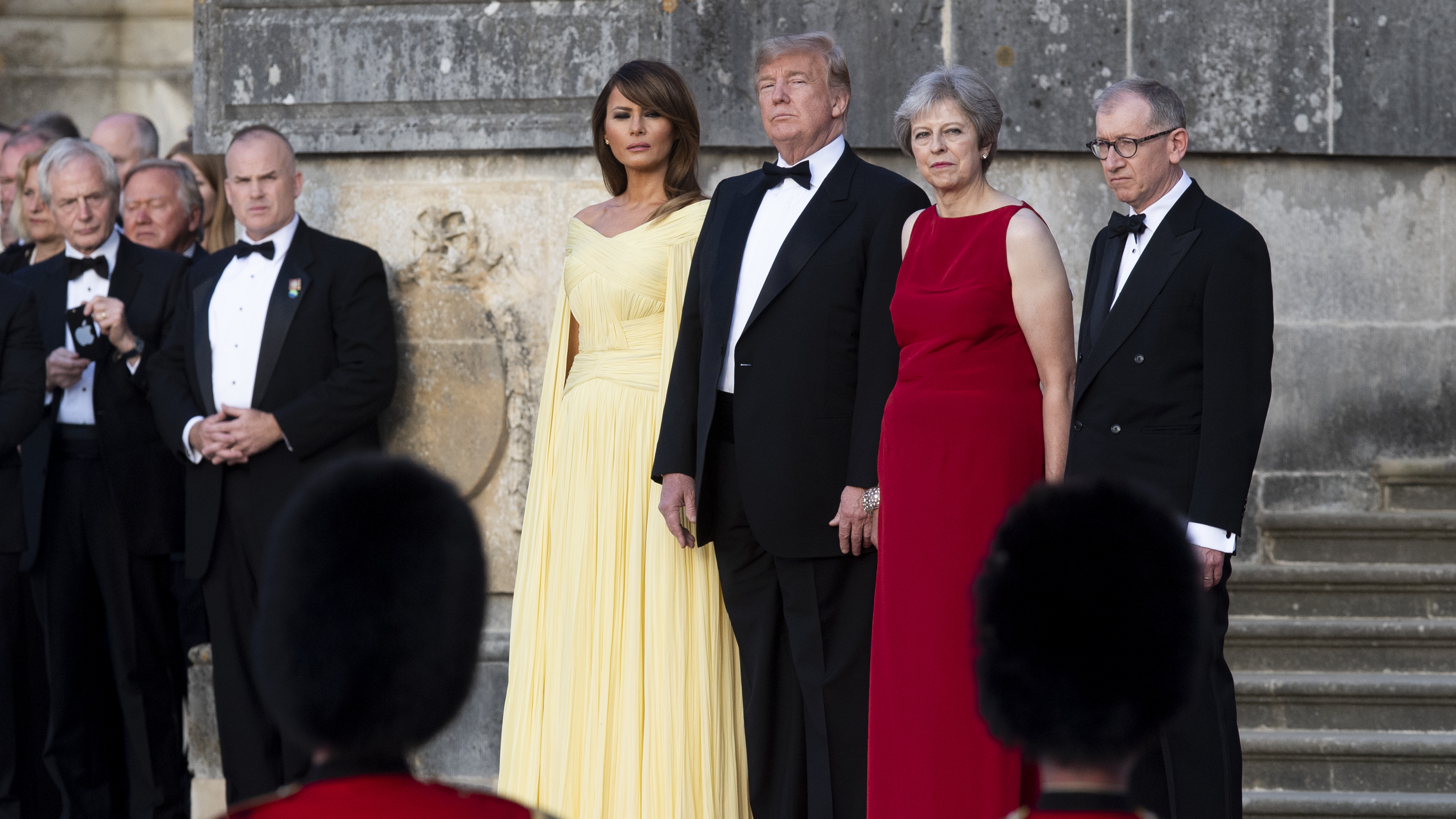 U.S. First Lady Melania Trump, President Trump, British Prime Minister Theresa May and her husband Philip May watch a live military performance by the bands of the Scots, Irish and Welsh Guards ahead of a dinner at Blenheim Palace, in Oxfordshire, U.K., on Thursday.