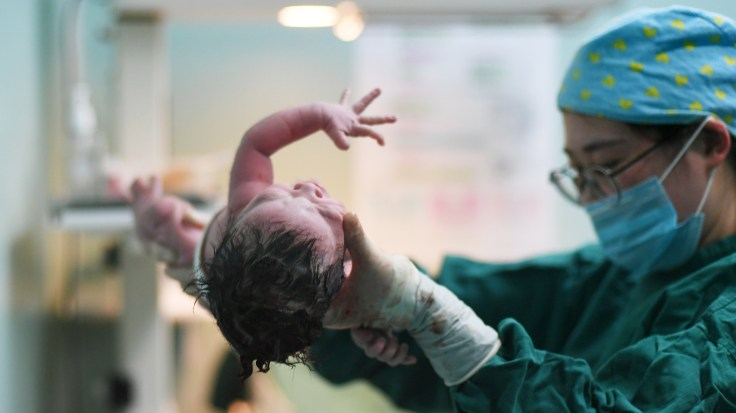 A newborn girl is the first baby born in the New Year at Nanjing Maternity and Child Health Hospital on January 1, 2018 in Nanjing, Jiangsu Province of China.
