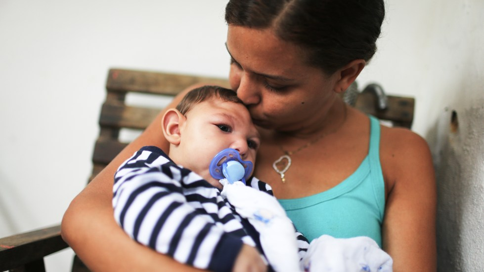 Mother Daniele Santos holds her baby Juan Pedro, who has microcephaly, on May 30, 2016, in Recife, Brazil. Researchers are now learning that Zika