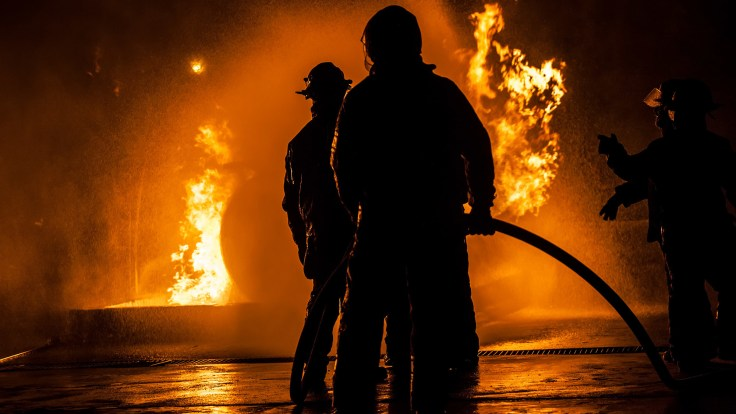 Firefighters are often exposed to carcinogens in the course of their work. Laws in many states say if they get cancer, it should be presumed to be linked to their work.