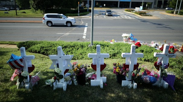 Five wooden markers stand in a makeshift memorial outside the Annapolis Capitol Gazette offices in Annapolis, Md., in early July, honoring the employees killed by a gunman just days before. The victims were editor Gerald Fischman, 61; editor and columnist Rob Hiaasen, 59; reporter and editor John McNamara, 56; reporter and columnist Wendi Winters, 65; and sales assistant Rebecca Smith, 34.