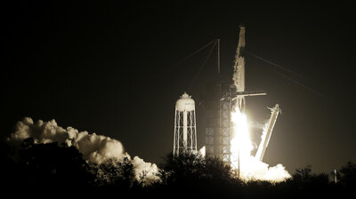 'Hard Capture Is Complete': SpaceX Capsule Docks With International Space Station