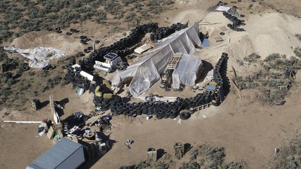 A ramshackle compound in the desert area of Amalia, N.M. Five former residents were indicted on terror and gun charges.