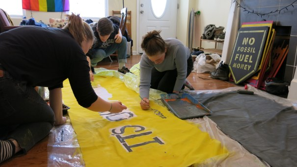 "Teenagers in Philadelphia prepare a banner for the ""U.S. Youth Climate Strike."" Students around the world have skipped school as a protest to call for more action on climate change."