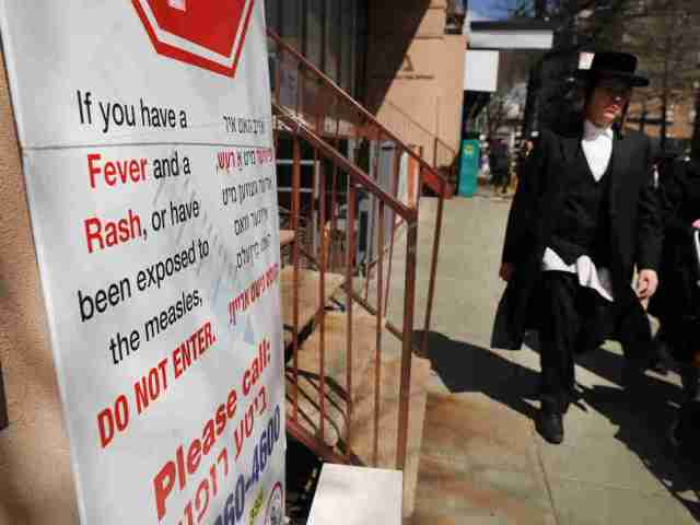 As a measles epidemic continues to spread, New York City Mayor Bill de Blasio recently announced a state of emergency and mandated residents of the ultra-Orthodox Jewish community in Williamsburg at the center of the outbreak to get vaccinated for the viral disease. (Photo by Spencer Platt/Getty Images)