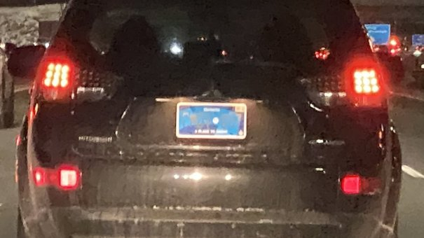 """Toronto videojournalist Andrew Collins noticed that the new plates are """"totally unreadable from a distance at night."""" He tweeted this still from a dash camera video."""