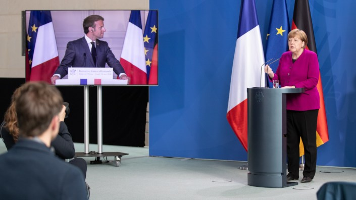 German Chancellor Angela Merkel and French President Emmanuel Macron hold a joint news conference via video on Monday to propose a European Union coronavirus recovery fund of 500 billion euros.