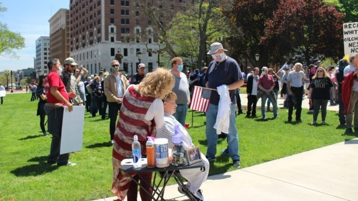 Barbers and hairstylists gave protesters a trim in a demonstration against Michigan