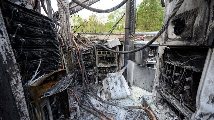 Damaged cabling and telecommunications equipment is pictured following a fire at a phone mast, attached to the chimney at the converted Fearnleys Mill residential apartment block complex in Huddersfield, northern England, on April 17. The fire came after a number of other cellphone were set on fire amid conspiracy theories of a link between 5G mobile technologies and the novel coronavirus.