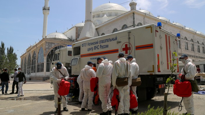 Russian Emergency Situations Ministry employees carry out disinfection of the Djuma Mosque in Makhachkala, Dagestan