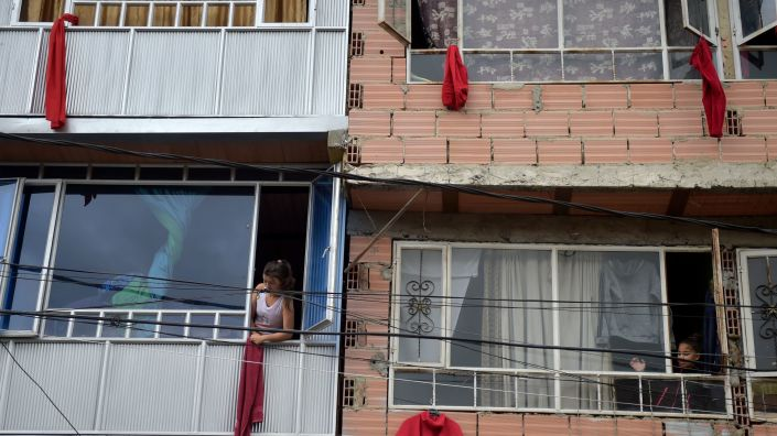 Residents of the Colombian capital Bogotá hang red rags from their windows and balconies to signal their need for help with food, on May 13.