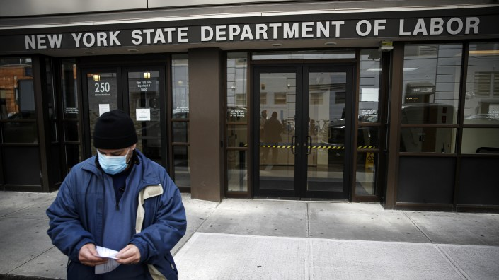 Visitors to the New York Department of Labor are turned away at the door by personnel because of closures over coronavirus concerns in New York on March 18. New York state began offering job protections for those required, or cautioned, to self-isolate or quarantine by a government entity.