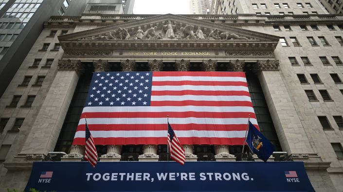 Stocks fell sharply Thursday after the Federal Reserve warned that the recovery will take a long time.