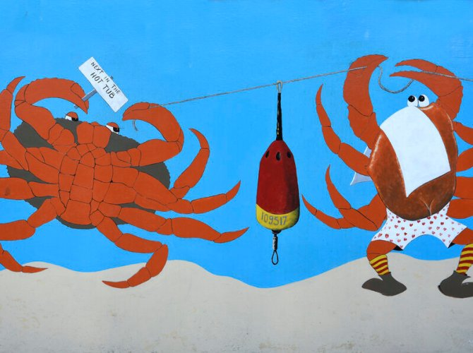 BANDON, OREGON - JUNE 14, 2019: A mural painted on the side of a Bandon, Oregon, seafood restaurant and market advertises crabs on the restaurant menu. (Photo by Robert Alexander/Getty Images)