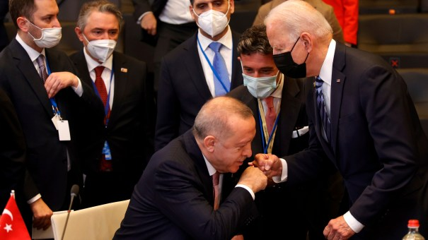 Turkish President Recep Tayyip Erdogan fist-bumps with Biden at the NATO summit Monday in Brussels. Biden and Erdogan met privately afterward to discuss some thorny issues.