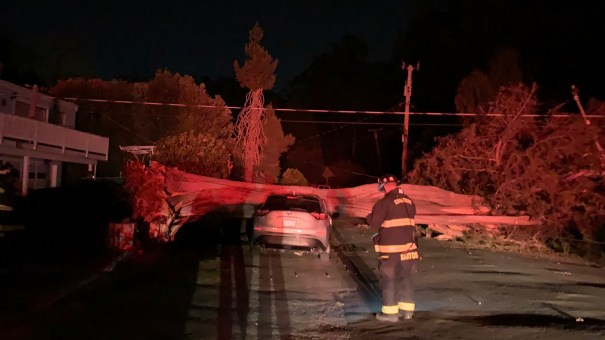 This early Monday photo provided by CalFire shows one of several vehicles damaged during a wind event in northern San Mateo County, Calif.