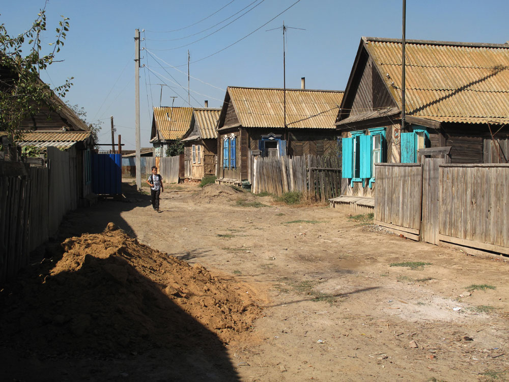 In Zelenga, the roads are unpaved and residents get water only a few hours a day