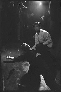 A wounded Kennedy lies on the kitchen floor.
