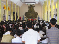 Parishioners gathered in the Thai Ha Church in Hanoi, Vietnam. The church is mobilizing its followers in a land dispute with the government. Many people at the service were bused in from nearby provinces (Michael Sullivan/NPR)