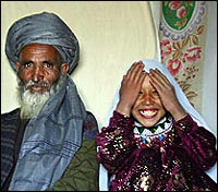 Roshan Qasem.. age 11 with her husband