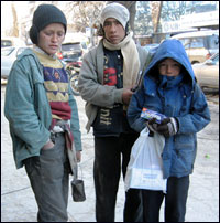 Ruzadin, 11, stands with fellow street children in Kabul.