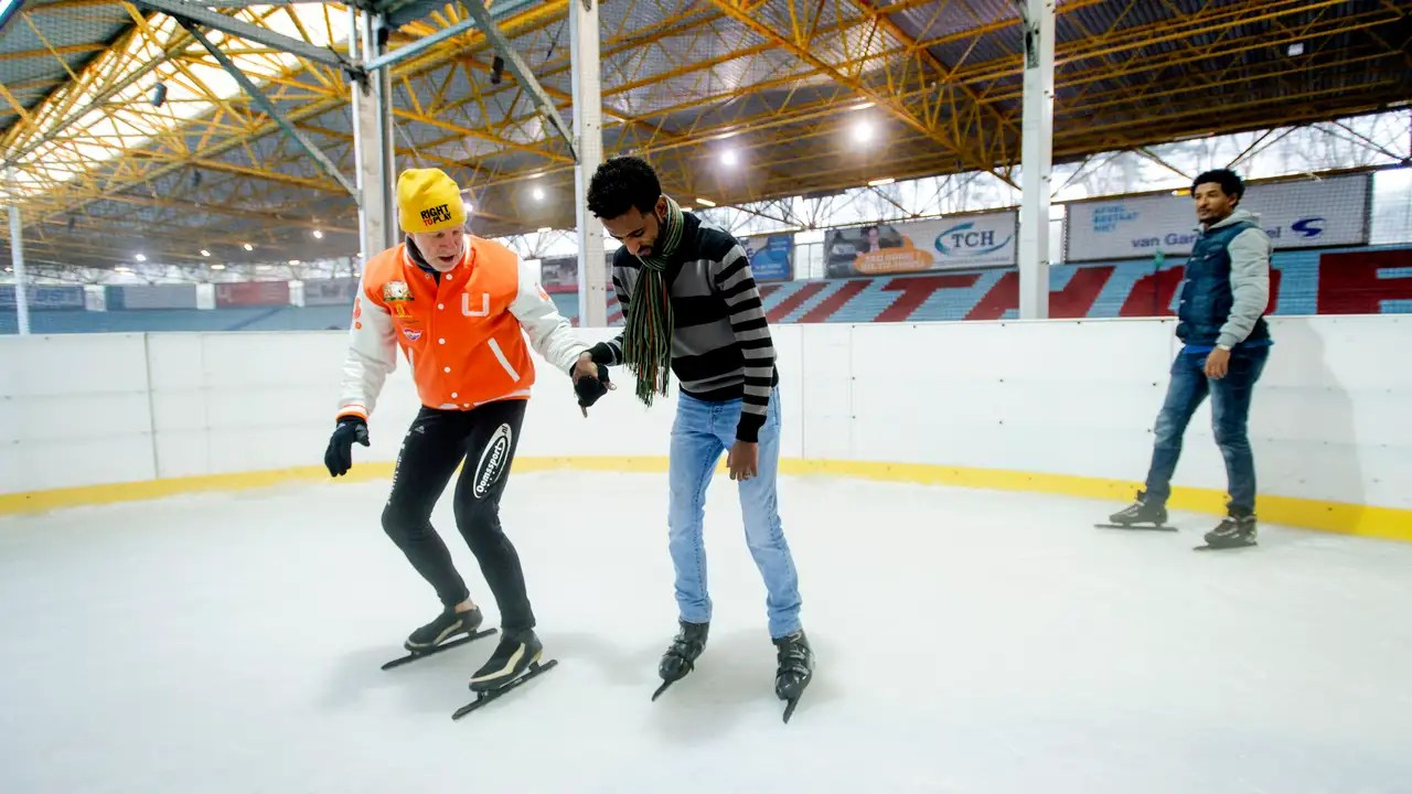 Refugee's skating lesson in Ede, ANP photo