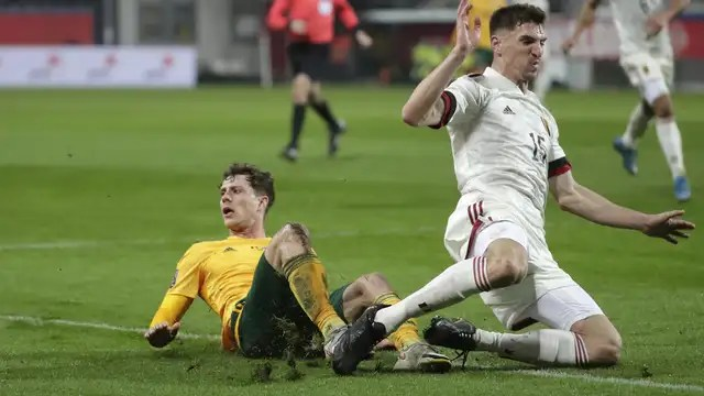 Thomas Meunier duels with Neco Williams during the duel with Wales.