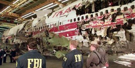 FBI agents and New York state police guard the reconstruction of TWA Flight 800 in Calverton. Photo / AP