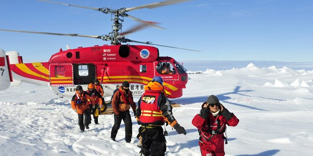 The crew of a Chinese icebreaker that had provided the helicopter said they were worried about their own ship's ability to move through the ice. Photo / AP