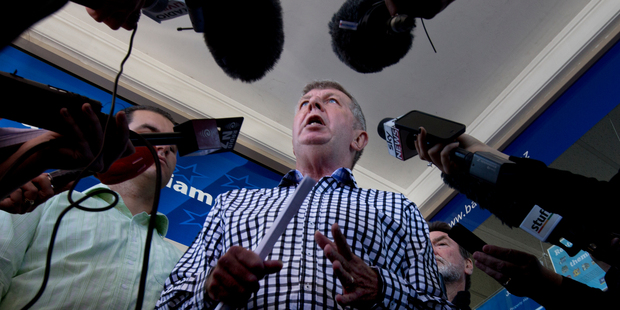 National Party MP Maurice Williamson talks to media outside his office in Pakuranga, after resigning as a minister. Details of new contact he had with police have been revealed. Photo / NZ Herald
